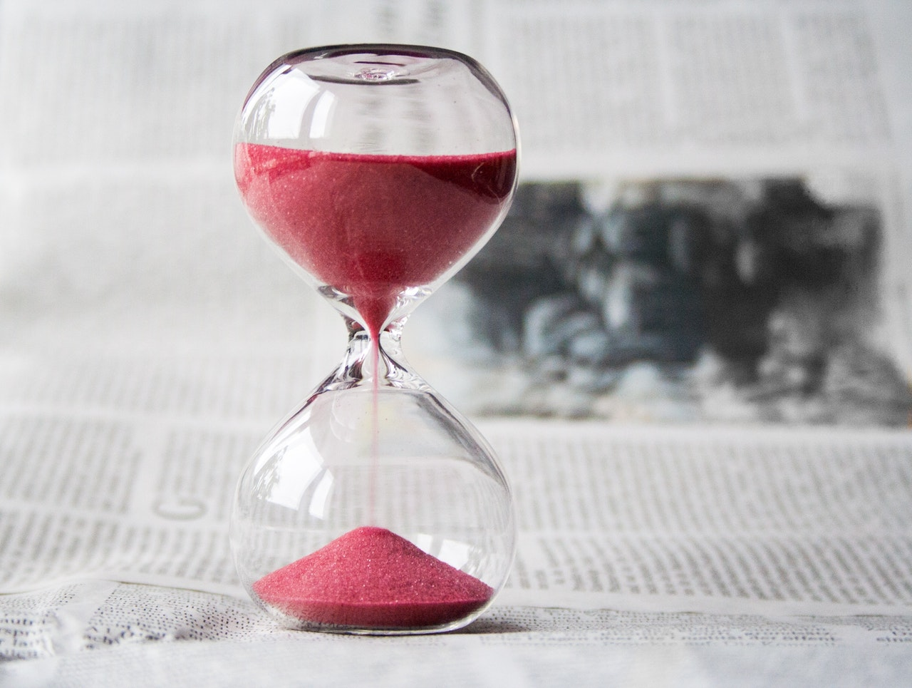 Logical Hiring follows punctuality at work. Image of an Hour glass.